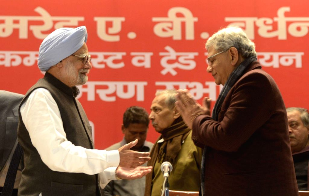 Former Prime Minister and Congress leader Manmohan Singh and CPI-M general secretary Sitaram Yechury during the condolence meeting of CPI leader A B Bardhan in New Delhi on Jan 19, 2016. - Sitaram Yechury and Manmohan Singh