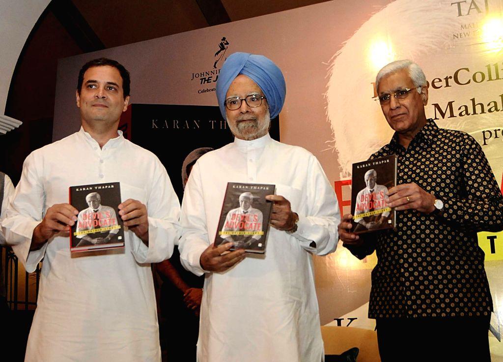 "Former Prime Minister Manmohan Singh, Congress president Rahul Gandhi releasing the book titled ""Devil's Advocate"" authored by journalist Karan Thapar in New Delhi on July 25, ... - Manmohan Singh and Rahul Gandhi"