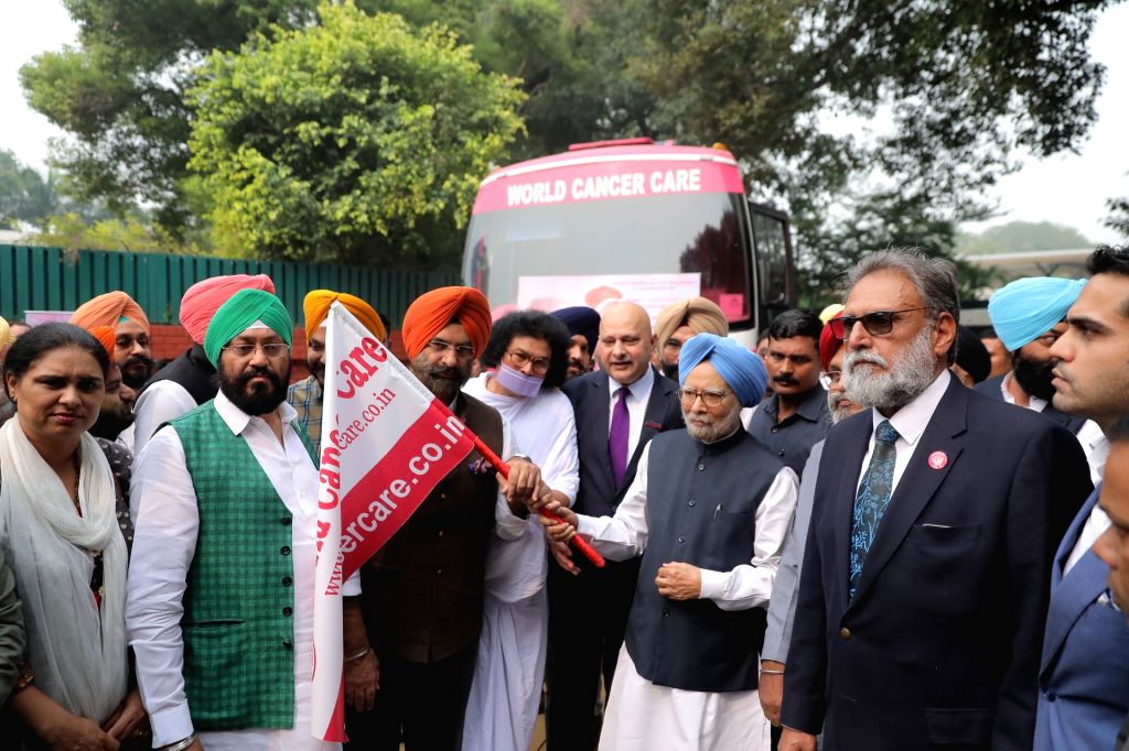 Former Prime Minister Manmohan Singh flags off Cancer Detection Units (Buses) from Kapurthala House in New Delhi on Oct 30, 2019. - Manmohan Singh