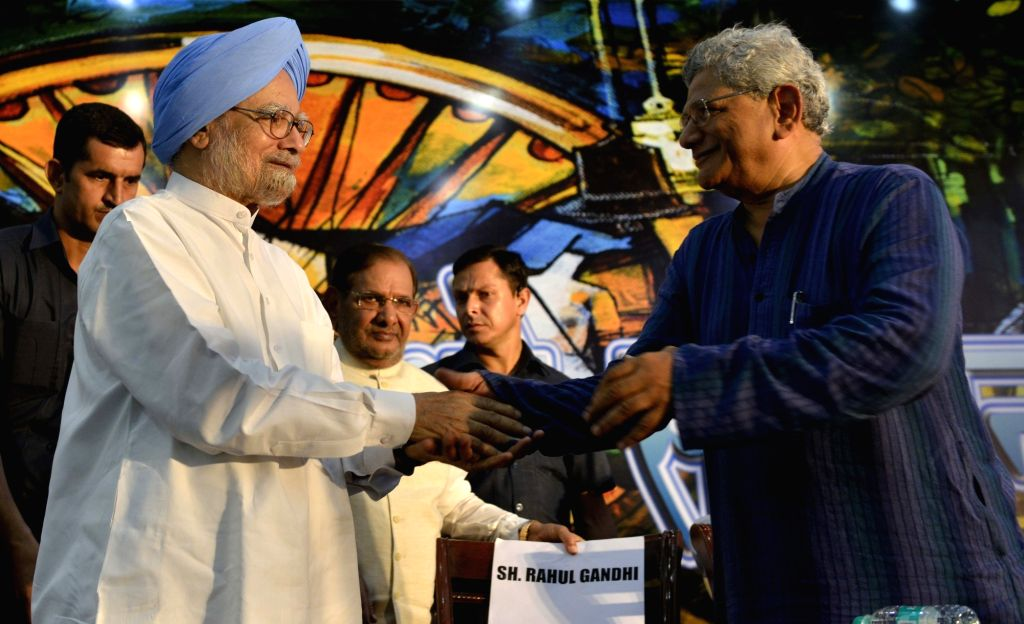 Former Prime Minister Manmohan Singh interacts with CPI(M) general secretary Sitaram Yehchury during 'Sajha Virasat Bachao' (Save Composite Culture) conference in New Delhi on Aug 17, 2017. - Manmohan Singh