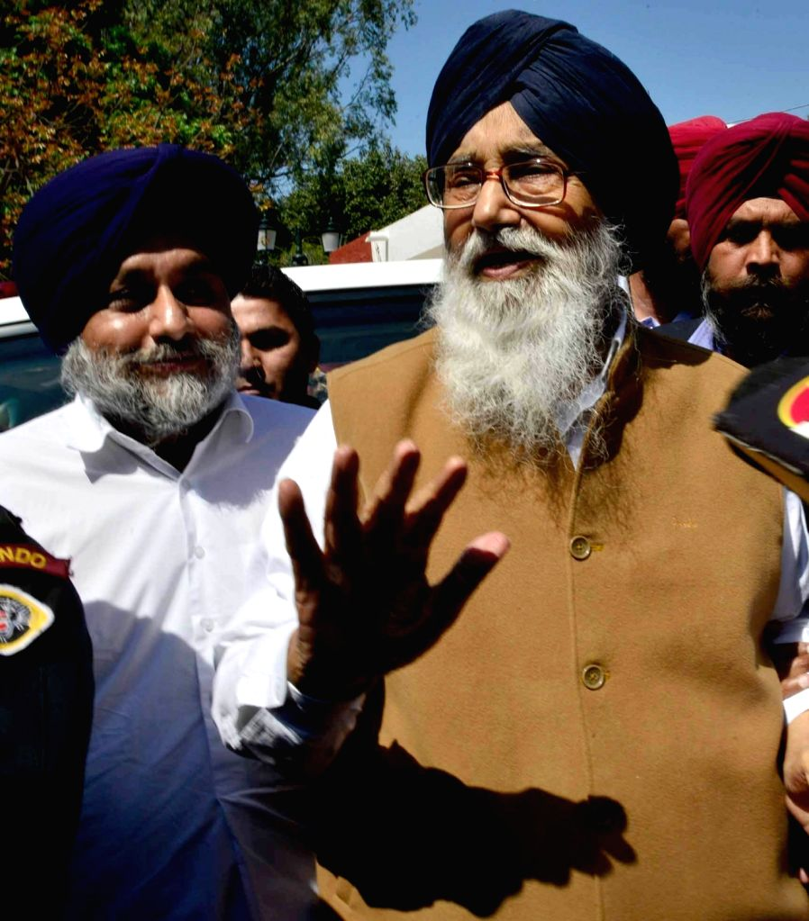 Former Punjab Chief Minister Parkash Singh Badal with Sukhbir Singh Badal addressing media persons after meeting Punjab Governor VP Singh Badnore in Chandigarh on March 12, 2017. - Parkash Singh Badal and Sukhbir Singh Badal