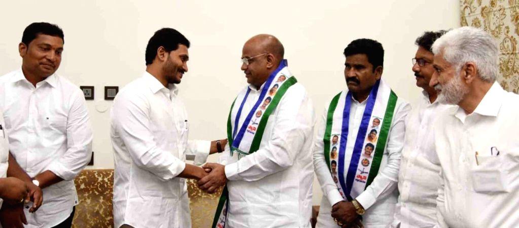 Former Rajahmundry MLA and Janasena leader Akula Satyanarayana joins YSRCP in the presence of Andhra Pradesh Chief Minister and YSRCP President Jagan Mohan Reddy, in Vijayawada on Oct 8, ... - Jagan Mohan Reddy