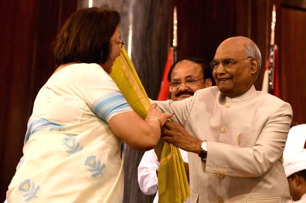 Former Rajya Sabha member Dr Najma Heptulla receives Outstanding Parliamentarian Award for the year 2013 from President Ram Nath Kovind during Outstanding Parliamentarian Award ceremony at ... - Najma Heptulla and Nath Kovind