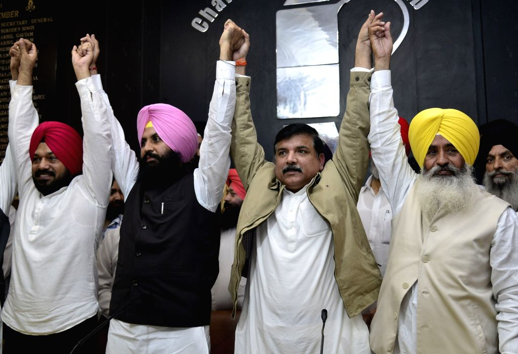 Former SAD Leaders and part of Awaaz-e-Punjab front Simarjit Singh Bains and Balwinder Singh Bains joins Aam Admi Party in the presence of AAP leader Sanjay Singh and partys Punjab State ... - Simarjit Singh Bains, Balwinder Singh Bains, Sanjay Singh and Gurpreet Singh