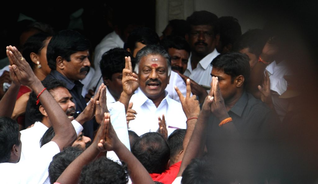 Former Tamil Nadu Chief Minister O. Panneerselvam shows victory sign on the merger of the two factions of the party at the AIADMK headquarters  in Chennai on Aug 21, 2017. - O. Panneerselvam