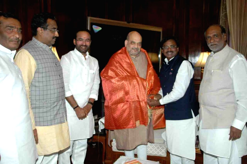 Former Telangana Rashtra Samiti leader G. Vivekanand joins BJP in the presence of Union Home Minister Amit Shah, Union MoS Home Affairs G. Kishan Reddy and party leaders K. Laxman and Ram ... - Amit Shah