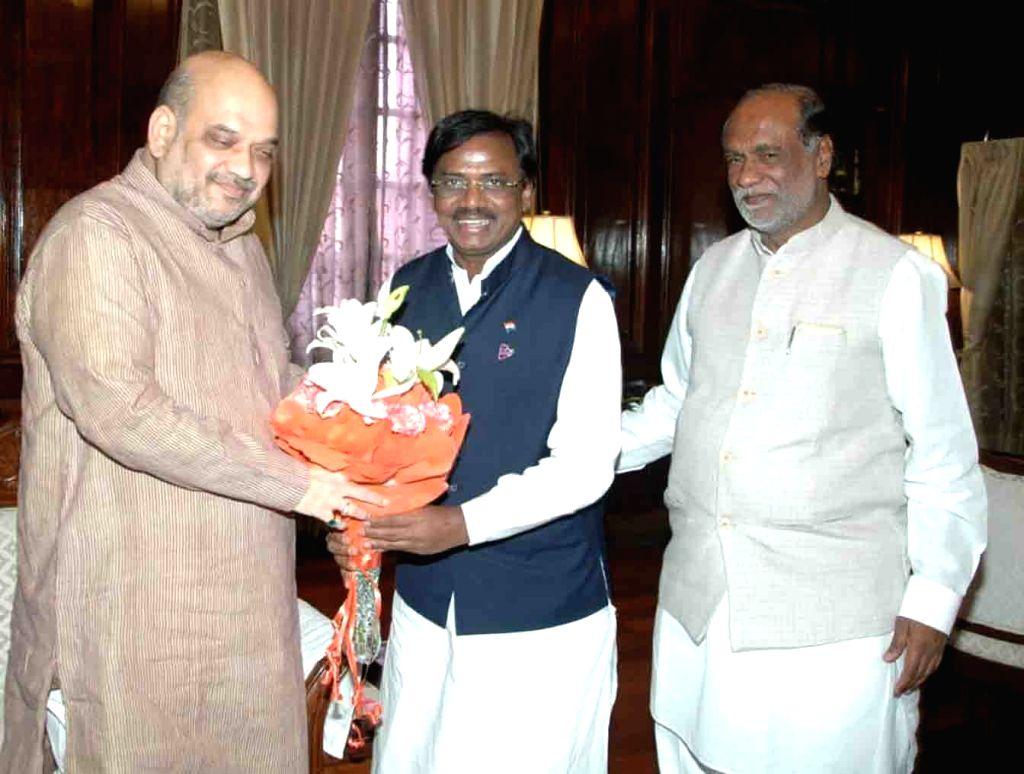 Former Telangana Rashtra Samiti leader G. Vivekanand joins BJP in the presence of Union Home Minister Amit Shah and Telangana party President K. Laxman, in New Delhi on Aug 9, 2019. - Amit Shah