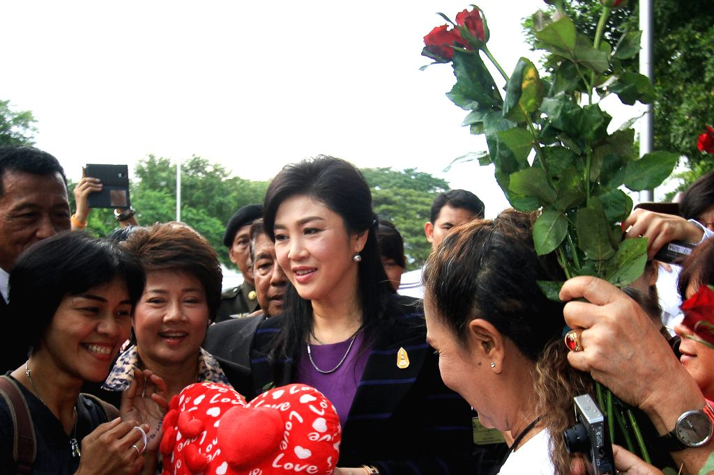 Former Thai Prime Minister Yingluck Shinawatra (C) arrives for her hearing at the Supreme Court in Bangkok, Thailand, Jan. 15, 2016. Yingluck has been alleged of ... - Yingluck Shinawatra