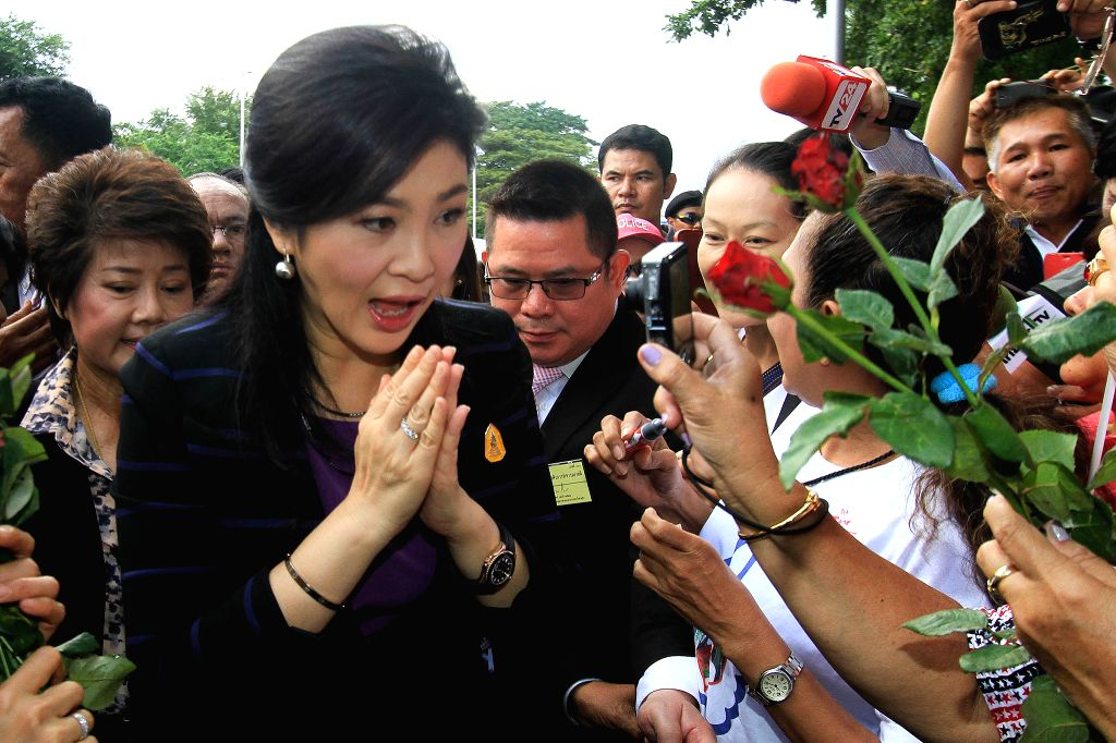 Former Thai Prime Minister Yingluck Shinawatra (L) arrives for her hearing at the Supreme Court in Bangkok, Thailand, Jan. 15, 2016. Yingluck has been alleged of ... - Yingluck Shinawatra
