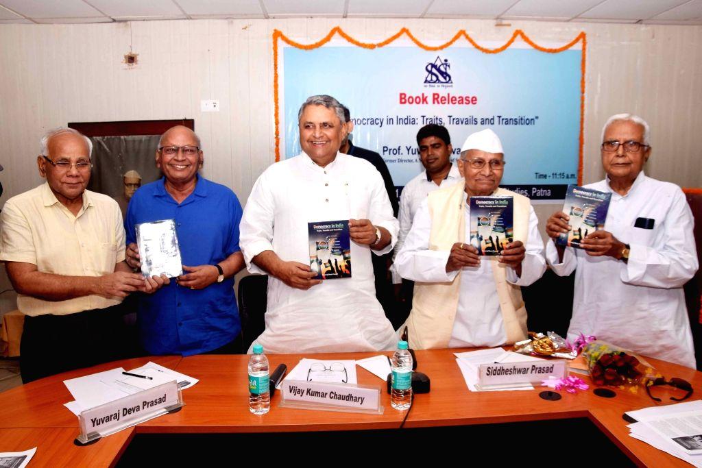 "Former Tripura Governor Siddheshwar Prasad and Bihar Legislative Assembly Speaker Vijay Kumar Chaudhary at the launch of the book ""Democracy in India: Traits, Travails and ... - Vijay Kumar Chaudhary"