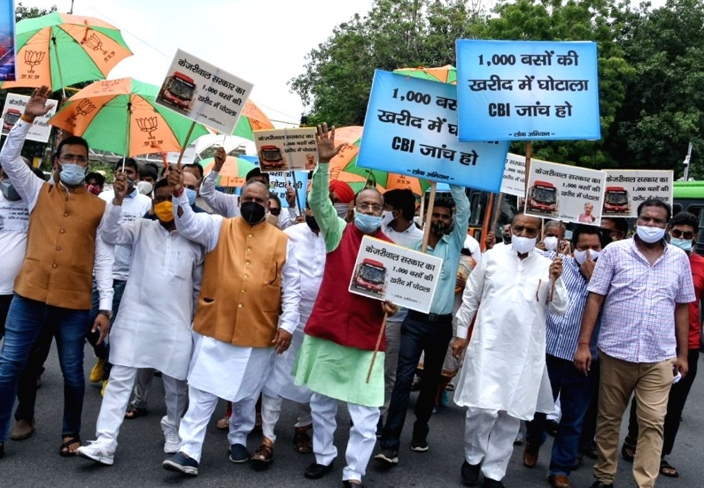 Former Union Minister Vijay Goel with supporters demonstration against Delhi govt. for 1000 bus deal scandal at ITO Chowk in new Delhi on Saturday June 19, 2021 - Vijay Goel