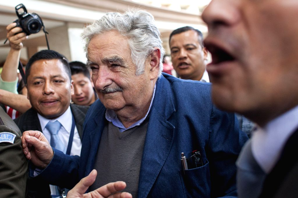 Former Uruguayan President Jose Mujica (C) arrives at Guatemala City, capital of Guatemala, on Aug. 17, 2015. According to local press, Mujica is visiting ...