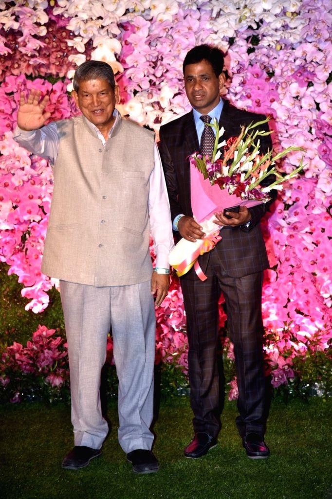 Former Uttarakhand Chief Minister Harish Rawat at the wedding reception of Akash Ambani and Shloka Mehta in Mumbai on March 10, 2019. - Harish Rawat, Akash Ambani and Shloka Mehta