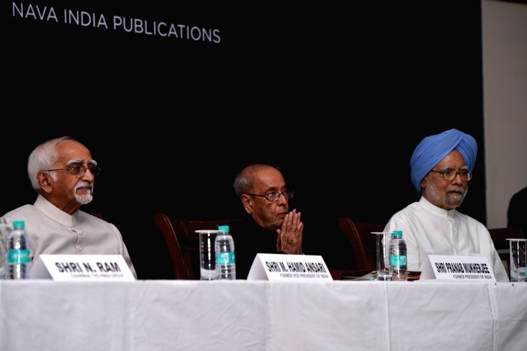 "Former Vice President Hamid Ansari, former President Pranab Mukherjee and former Prime Minister Manmohan Singh during the launch of  A. Gopanna's book ""Jawaharlal Nehru: An ... - Manmohan Singh and Pranab Mukherjee"