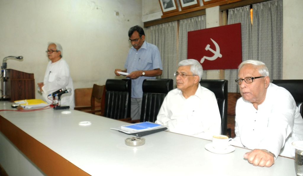 Former West Bengal chief minister and CPI (M) leader Buddhadeb Bhattacharjee with CPI(M) general secretary Prakash Karat during a CPI(M) State committee meeting in Kolkata, on Nov 5, 2014. Also seen . - Biman Bose
