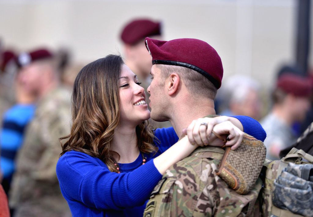 Fort Bragg (U.S.):  Paratrooper Kory White hugs his wife Kaci after returning from Afghanistan at Fort Bragg, North Carolina, the United States, Dec. 5, 2014.  Approximately 100 Paratroopers arrived .
