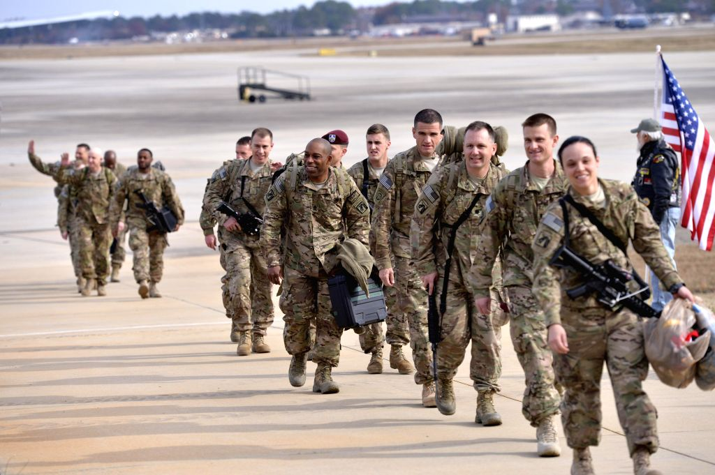 Fort Bragg (U.S.):  Paratroopers from the XVIII Airborne Corps headquarters returned from Afghanistan arrive at Green Ramp at Fort Bragg, North Carolina, the United States, Dec. 5, 2014.  ...
