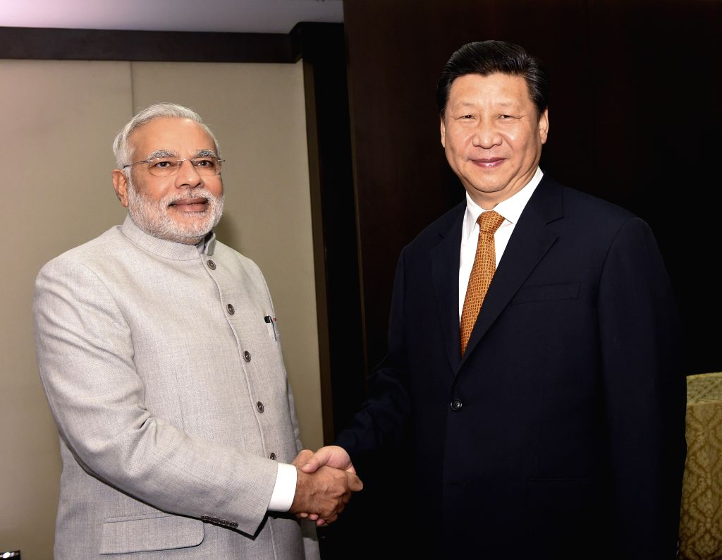 Chinese President Xi Jinping(R) meets with Indian Prime Minister Narendra Modi in Fortaleza, Brazil, July 14, 2014.