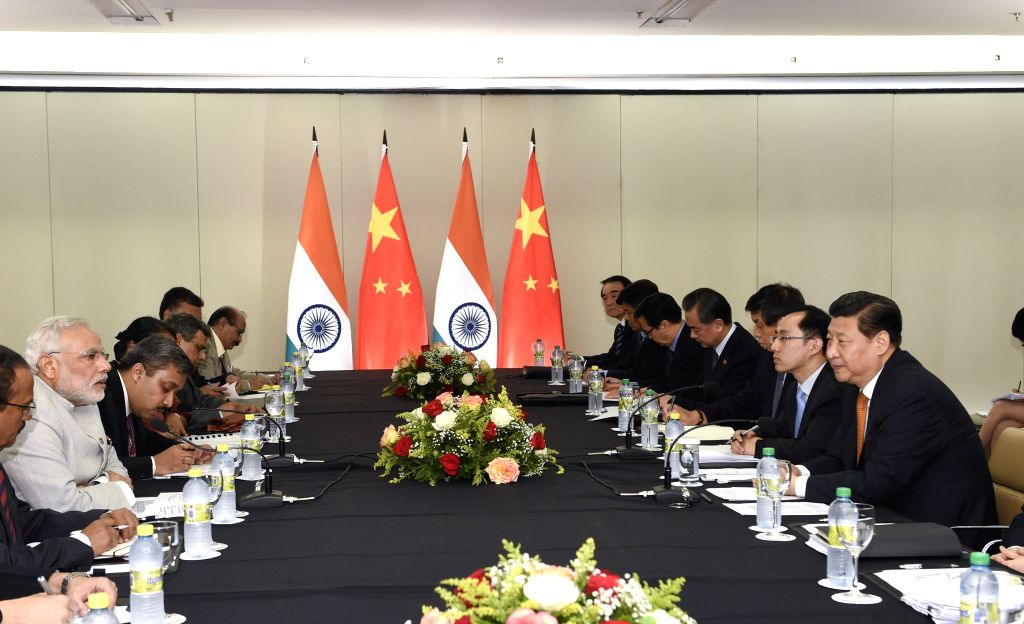 Chinese President Xi Jinping(1st R) meets with Indian Prime Minister Narendra Modi in Fortaleza, Brazil, July 14, 2014.