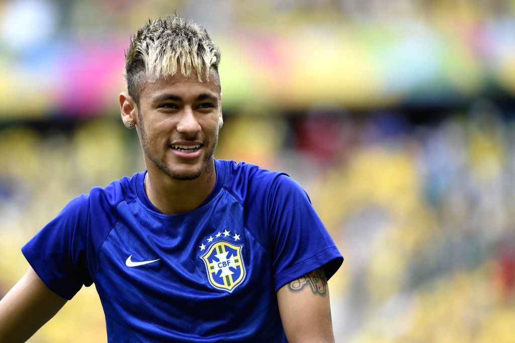 Brazil's Neymar reacts during a warm-up session prior to a Group A match between Brazil and Mexico of 2014 FIFA World Cup at the Estadio Castelao Stadium in ...
