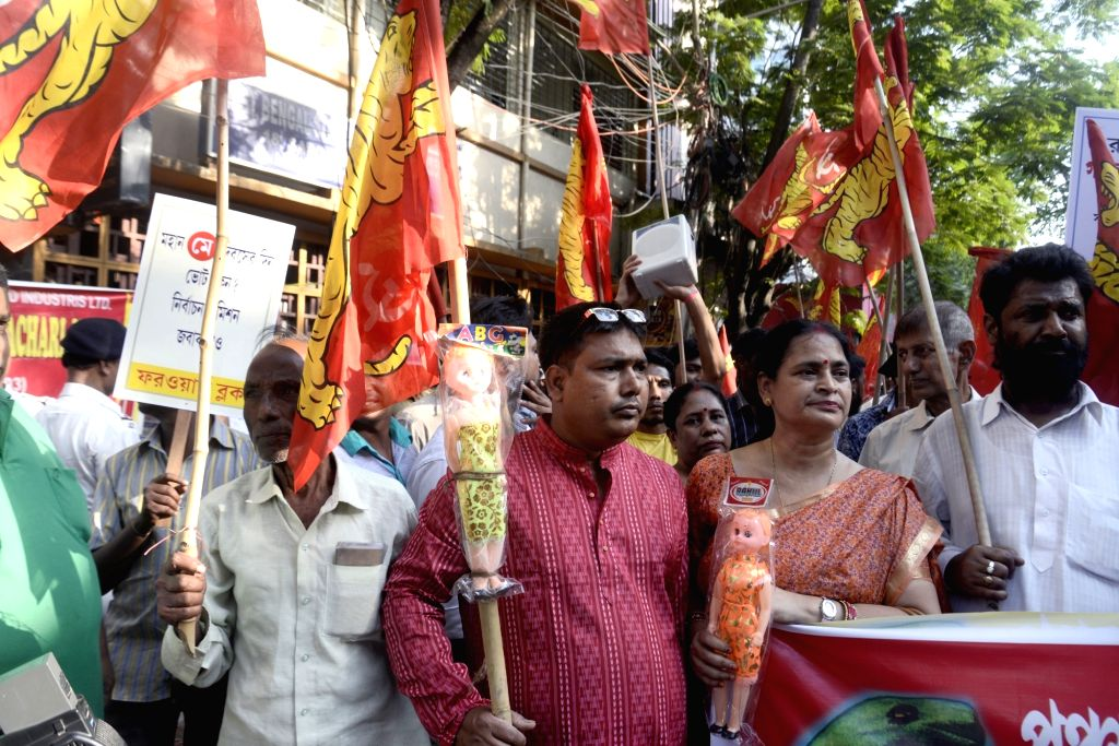 Forward Bloc activists participate in a demonstration against violence over Panchayat nomination ahead of Panchayat polls, in Kolkata on April 5, 2018.