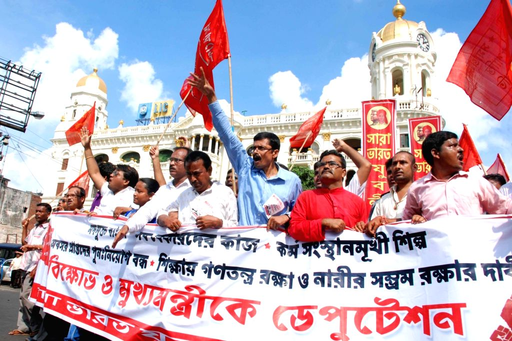 Forward Bloc activists participate in a rally against West Bengal government in Kolkata, on Sept 20, 2016.