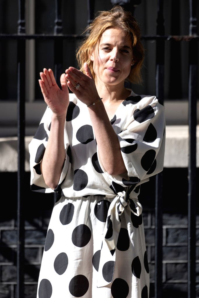 """Founder of """"Clap for Carers"""" Annemarie Plas claps outside 10 Downing Street to mark the 72nd anniversary of the National Health Service (NHS) in London, ..."""