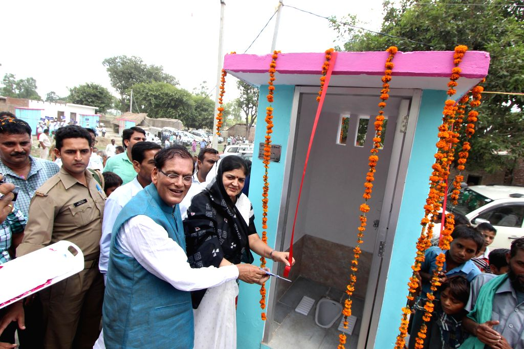 Founder of Sulabh International Dr. Bindeshwar Pathak hands over a toilet built by the organisation at Katra Sadatganj village of Uttar Pradesh's Budaun district to the people on Aug 31, 2014. Two ... - Bindeshwar Pathak
