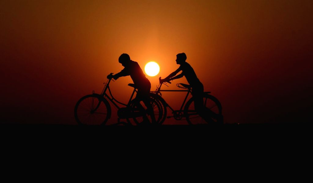 Four migrant workers embark on bicycles from Vijayawada to Agra. (Photo: IANS)