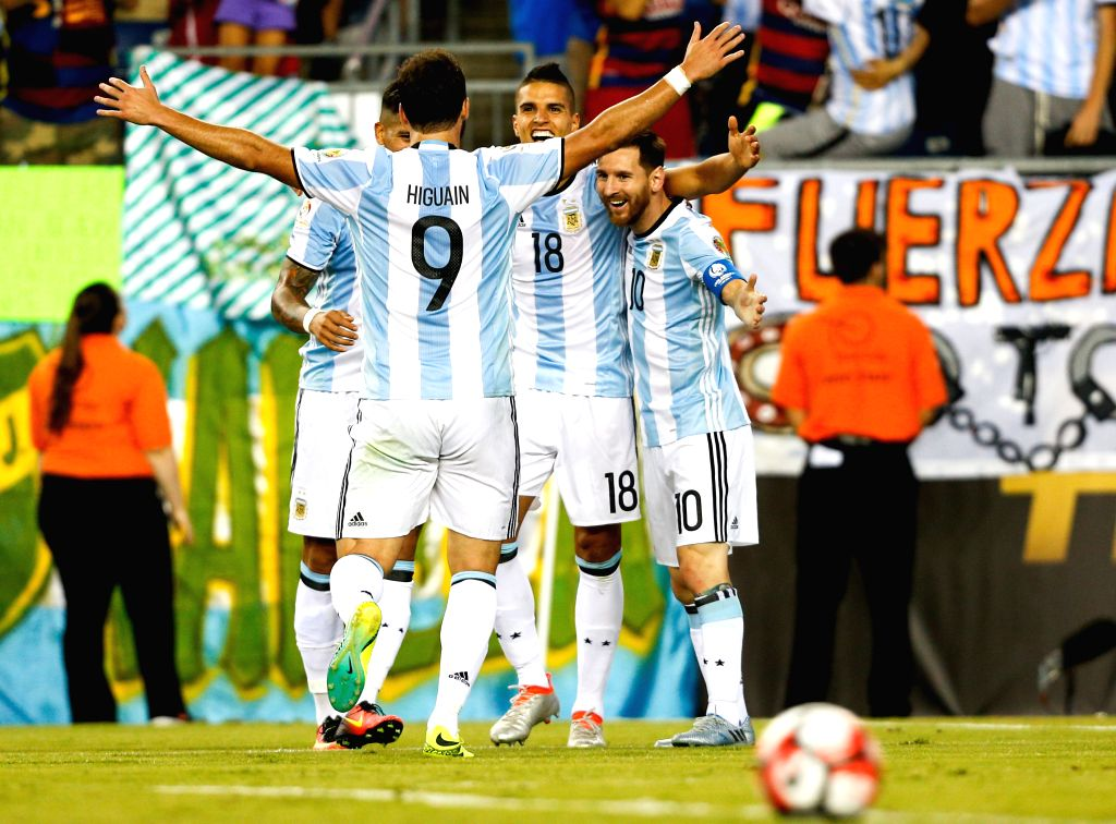 FOXBOROUGH, Jun. 19, 2016 - Erik Lamela (2nd R) of Argentina celebrates scoring with teammates Lionel Messi (1st R) and Gonzalo Higuain during the quarterfinal match of 2016 Copa America soccer ...