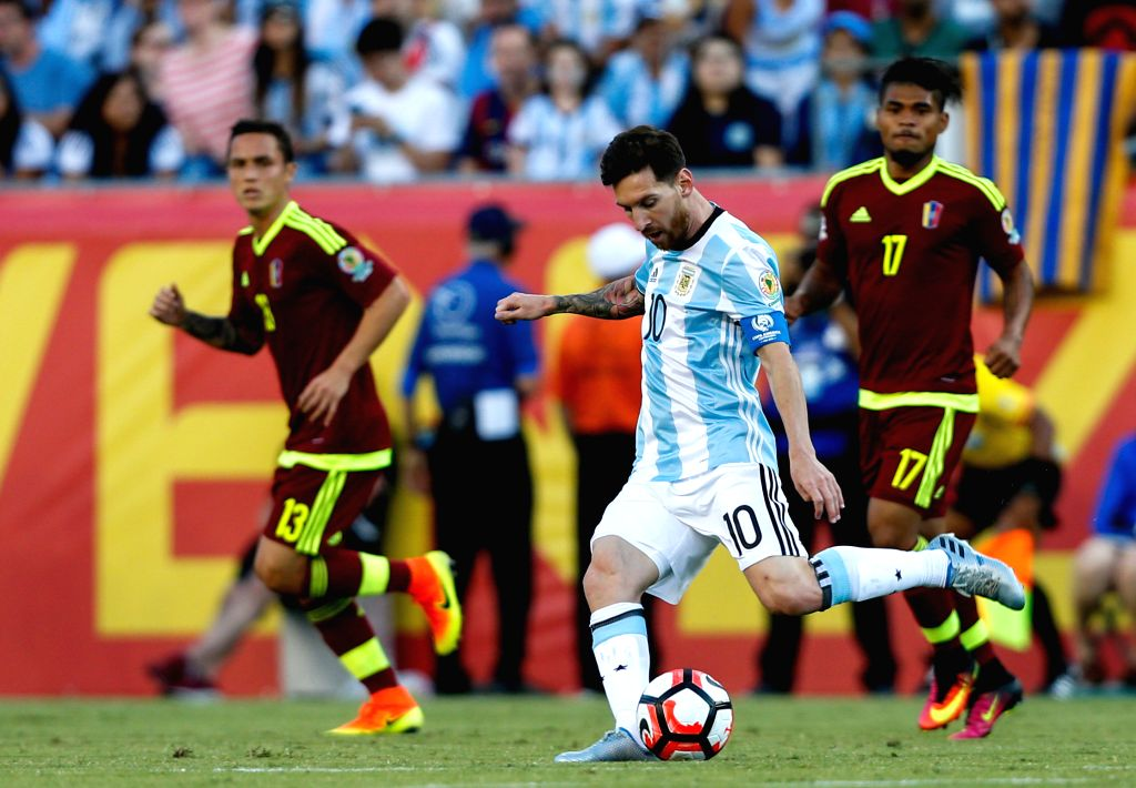 FOXBOROUGH, June 19, 2016 - Lionel Messi (Front) of Argentina passes the ball during the quarterfinal match of 2016 Copa America soccer tournament against Venezuela at Gillette Stadium in Foxborough, ...