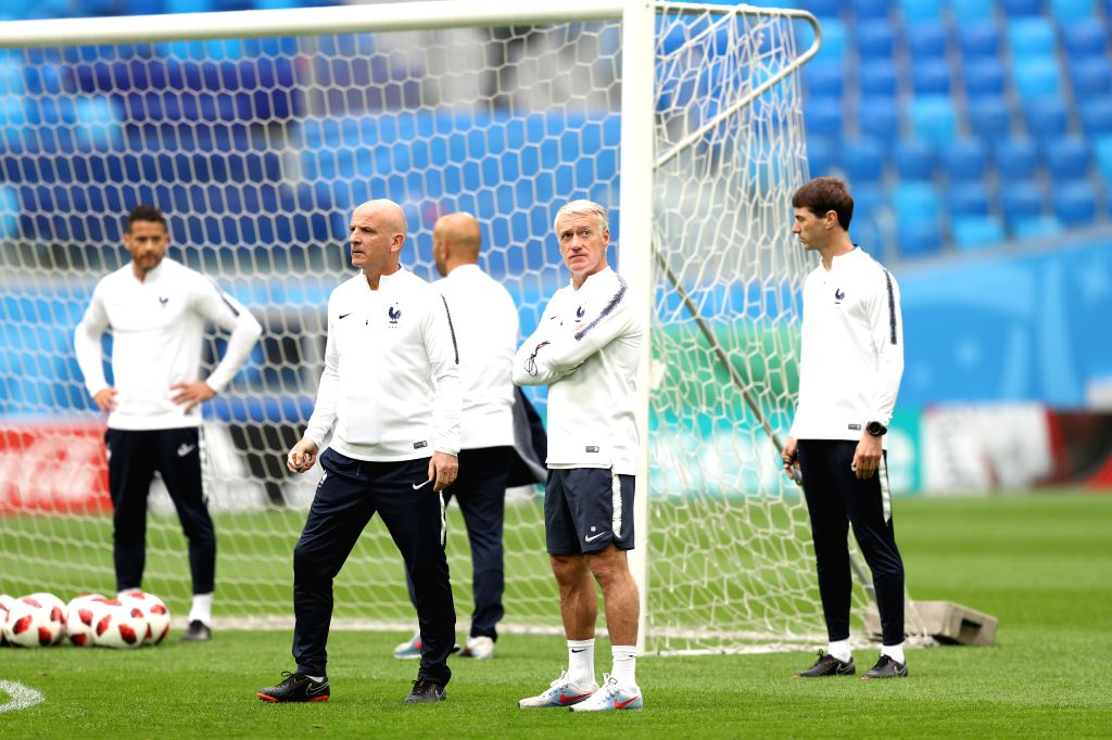 France's head coach Didier Deschamps (2nd R) leads a training session in Saint Petersburg, Russia, on July 9, 2018.