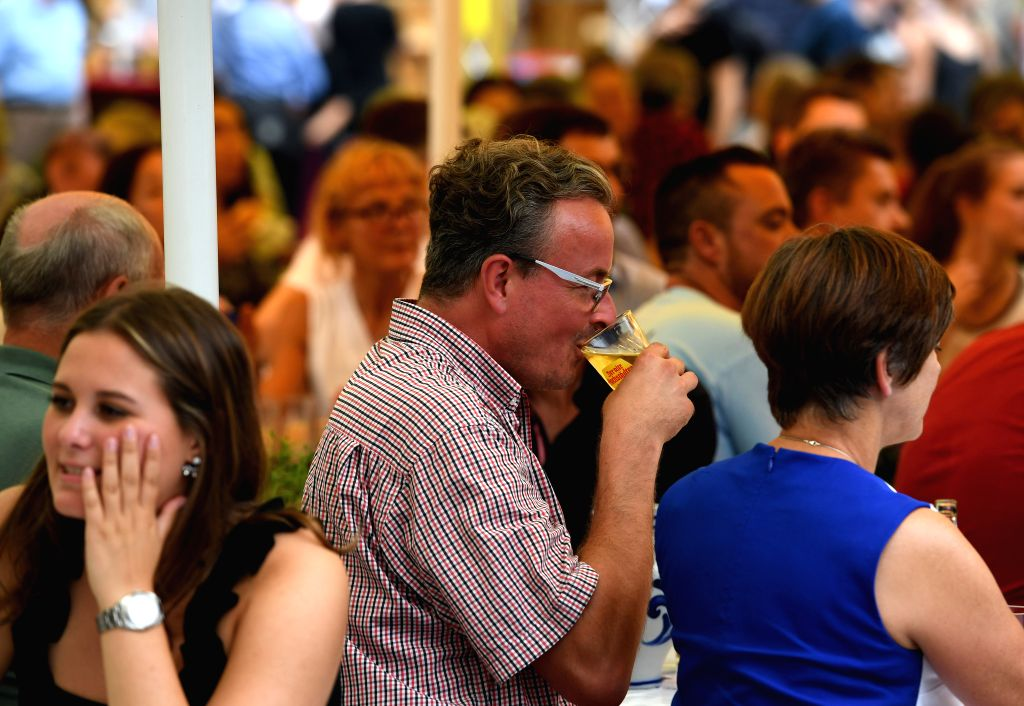 FRANKFURT, Aug. 9, 2019 - People visit the Frankfurt Apple Wine Festival in Frankfurt, Germany, on Aug. 9, 2019. The Frankfurt Apple Wine Festival is held here from Aug. 9 to 18. Frankfurt's apple ...