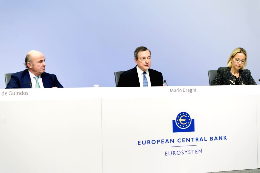FRANKFURT, Dec. 14, 2018 - European Central Bank (ECB) President Mario Draghi (C) and Vice-President Luis de Guindos (L) attend a press conference at the ECB headquarters in Frankfurt, Germany, on ...