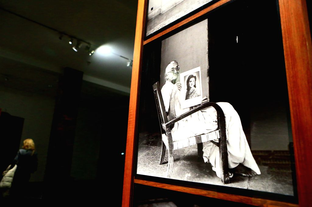 """A visitor watches photos at the exhibition of """"Dayanita Singh Go Away Closer"""" at the Museum for Modern Art in Frankfurt, Germany, on Dec.17, 2014. The .. - Dayanita Singh G"""