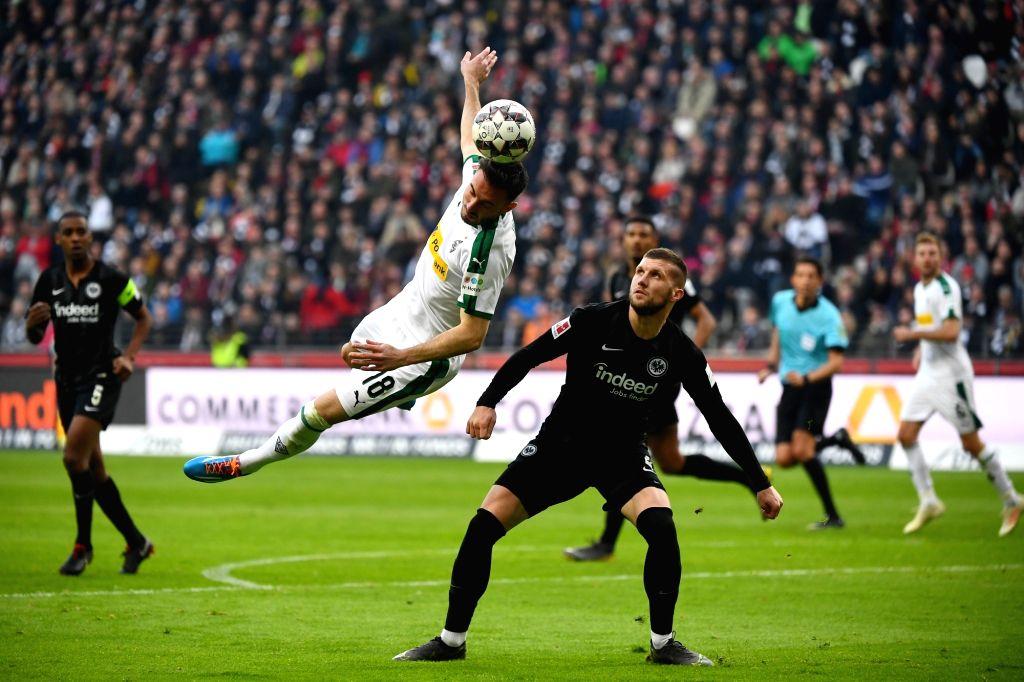 FRANKFURT, Feb. 18, 2019 - Josip Drmic (L) of Moenchengladbach vies with Ante Rebic of Frankfurt during the Bundesliga match between Eintracht Frankfurt and Borussia Moenchengladbach in Frankfurt, ...