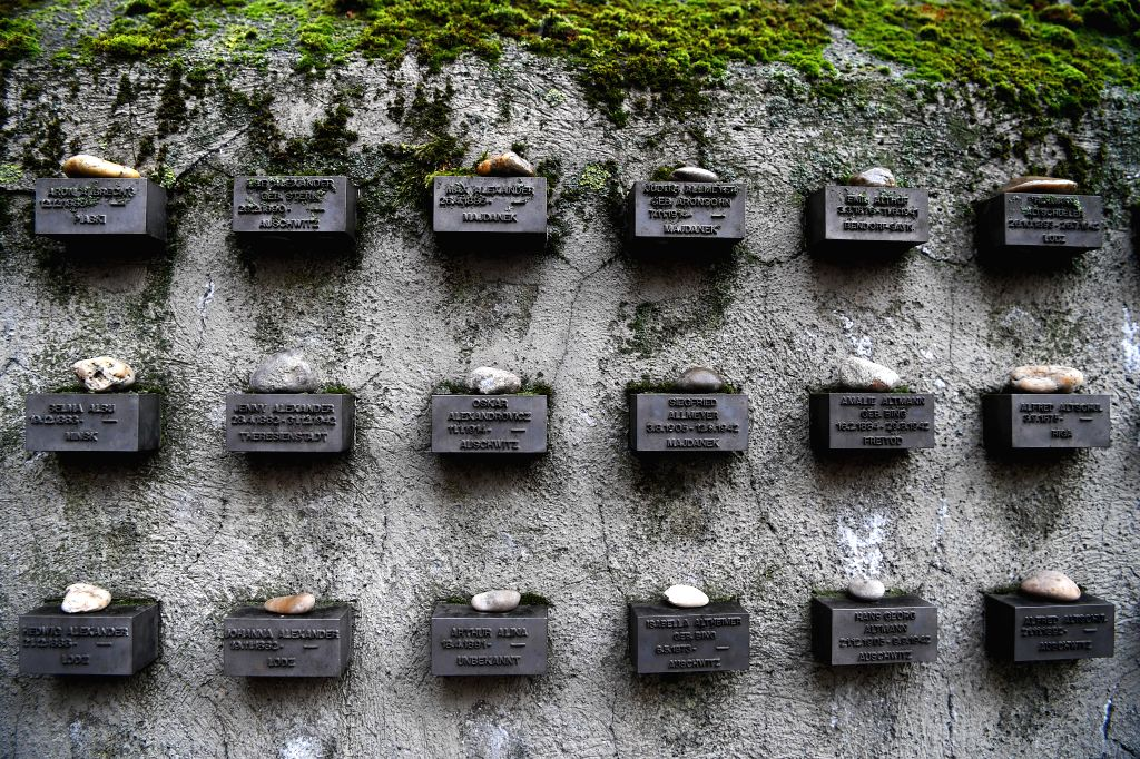 FRANKFURT, Jan. 27, 2019 - Photo taken on Jan. 27, 2019 shows the small blocks on the wall of the Old Jewish Cemetery in Frankfurt, Germany. The 286-meter-long wall contains more than 11,900 small ...