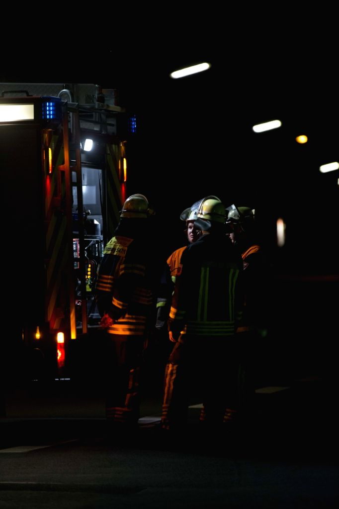 FRANKFURT, July 19, 2016 - Firefighters work at the site of an attack near Wuerzburg in the southern German state of Bavaria, on July 19, 2016. An axe wielding man wounded four passengers in a late ...