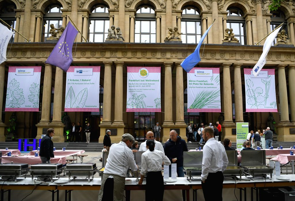 FRANKFURT, June 6, 2019 - Banners introducing green sauce are seen outside Frankfurt Stock Exchange during the Green Sauce Festival in Frankfurt, Germany, on June 6, 2019. The Green Sauce is one of ...