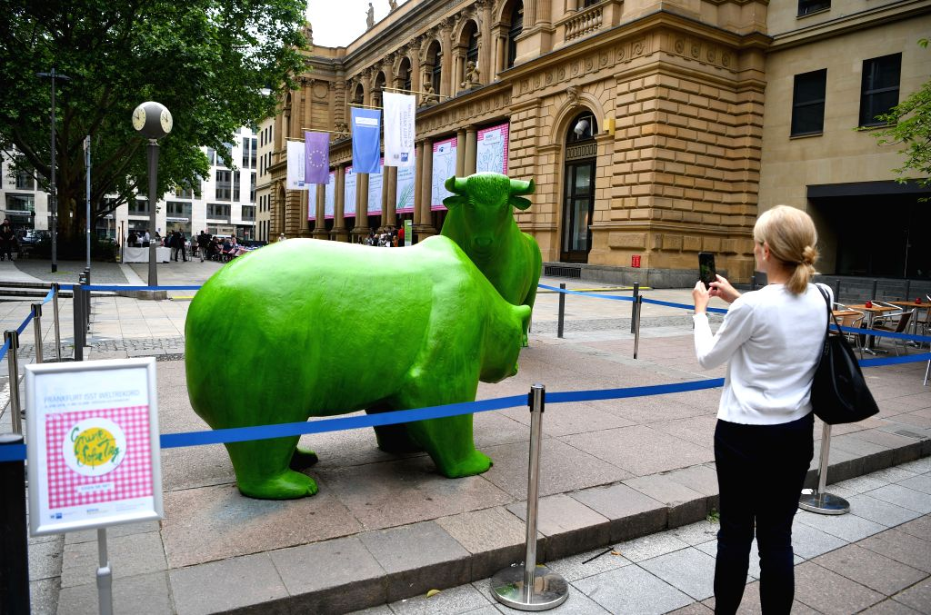 FRANKFURT, June 6, 2019 - Bull and bear sculptures in front of the Frankfurt Stock Exchange are painted green during the Green Sauce Festival in Frankfurt, Germany, on June 6, 2019. The Green Sauce ...