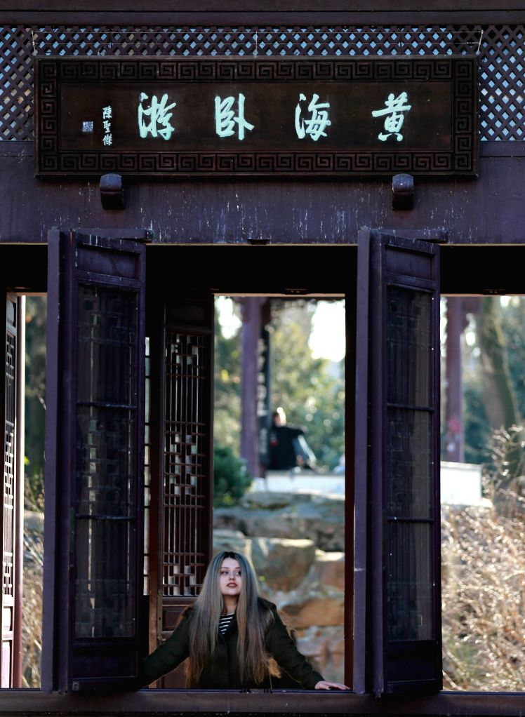 FRANKFURT, March 14, 2017 - People visit the Chinese Garden in Frankfurt, Germany, on March 13, 2017. The Chinese Garden was built in 1989 and covers an area of 4,000 square meters.