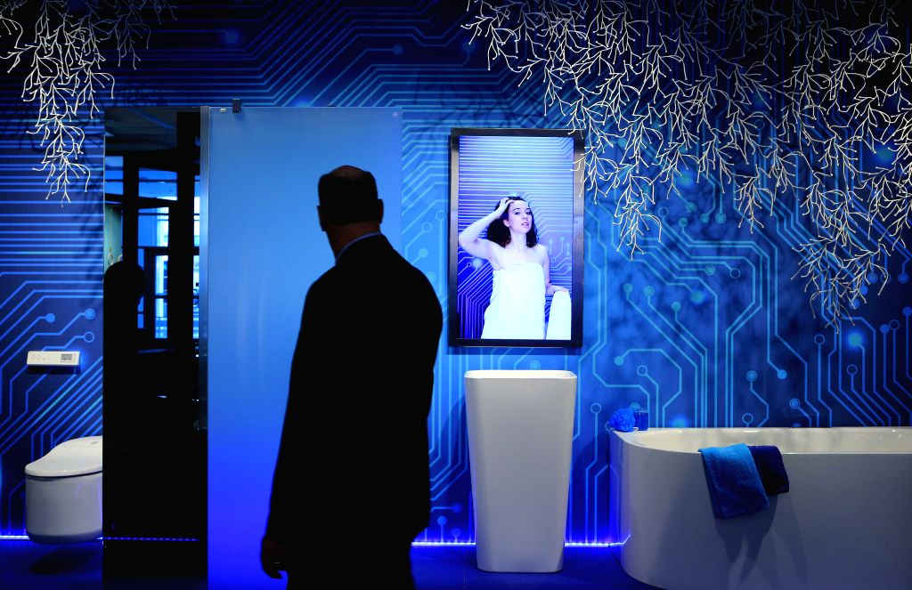 """FRANKFURT, March 15, 2017 - A man visits """"Pop Up My Bathroom"""" at the leading world trade fair ISH in Frankfurt, Germany, on March 14, 2017. The ISH trade fair opened in Frankfurt on ..."""
