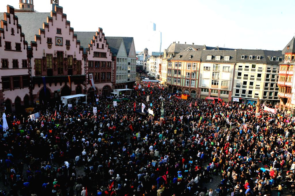 Supporters of Blockupy Alliance demonstrate after the European Central Bank (ECB) officially inaugurated its new headquarters in Frankfurt, Germany, on March 18, ...