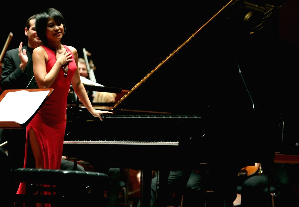 Young pianist Wang Yujia (L) reacts to applause after her premiere at the Old Opera House in Frankfurt, Germany on March 3, 2015.