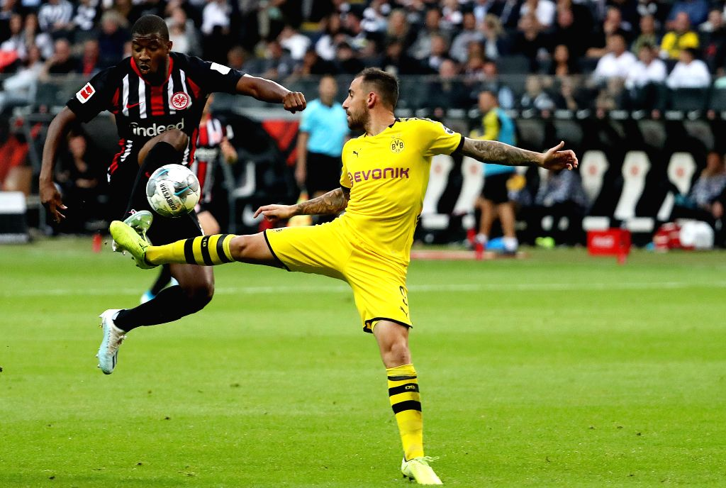 FRANKFURT, Sept. 23, 2019 - Almamy Toure (L) of Frankfurt vies with Paco Alcacer of Dortmund during the Bundesliga soccer match between Borussia Dortmund and Eintracht Frankfurt in Frankfurt, ...
