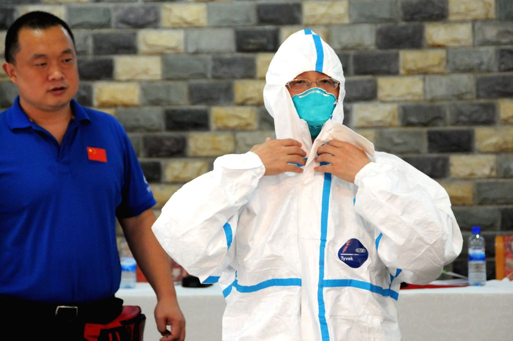 Members of Chinese medical expert team demonstrate during a training with Sierra Leone medical workers in Freetown, Sierra Leone, Aug. 14, 2014. China has sent ...