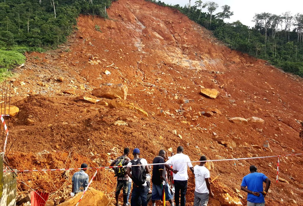 FREETOWN, Aug. 15, 2017 - People gather at the mudslide site in Freetown, Sierra Leone, on Aug. 15, 2017. Sierra Leone's President Ernest Bai Koroma has declared seven days of mourning across the ...