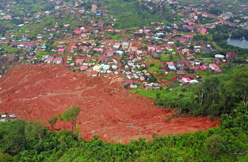 FREETOWN, Aug. 17, 2017 - Aerial photo taken on Aug. 17, 2017 shows the mudslide site in Freetown, Sierra Leone. Altogether 331 bodies have been taken to the morgue by the rescue team following the ...