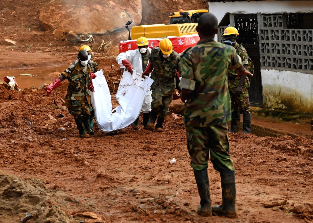 FREETOWN, Aug. 17, 2017 - Bodies of the mudslide victims are tranferred out of the site of the mudslide in Freetown, capital of Sierra Leone, on Aug. 17, 2017. Altogether 331 bodies have been taken ...