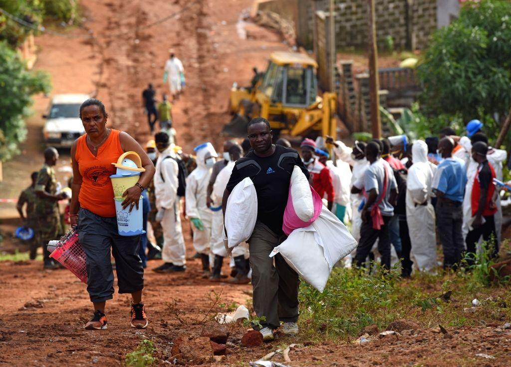FREETOWN, Aug. 17, 2017 - Local people transfer their belongings to a secured area on the site of the mudslide in Freetown, capital of Sierra Leone, on Aug. 17, 2017. Altogether 331 bodies have been ...